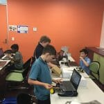 Students coding their robot in our after school program